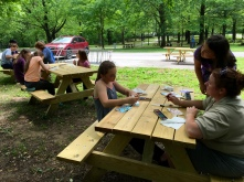 Here are three picnic tables full of artistic expression underway!