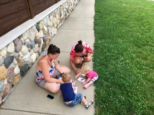 Even the youngest artists can handle the water brushes with a little help from the grownups