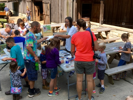 The afternoon painting activity was set up outside the hay press barn and museum, where a demonstration of the hay press took place later that day.