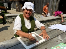 Ann, a volunteer at the Living Pioneer Farmstead, joined the painting activity as part of their children's craft on special weekends. She provided frames that could be decorated with stickers for everyone's artwork!