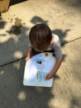 This young artist was too busy fine-tuning his artwork to look at the camera. I know the feeling!