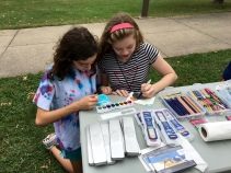 These two young artists were trying out the glitter watercolor paints for added glitz to their artwork.