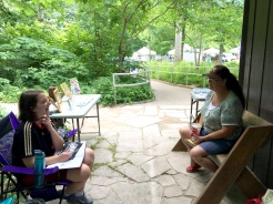 My daughter and one of the DNR volunteers, both artists, discussed painting techniques and mediums in the shade.