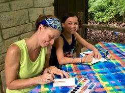 All you need is a picnic table, colorful tablecloth, simple art supplies and some time to have fun!
