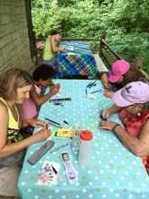 Artists had a choice of sitting outside at the two picnic tables or going inside the nature center to enjoy the air-conditioning. Most still chose the outside. Wonder why?