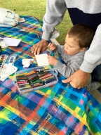 The watercolor crayons are easy to grip and a big hit with this young artist.