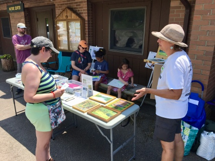 We had a steady flow of visitors checking out the art supplies and a display of oil paintings from various state parks.