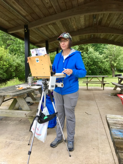 A sturdy shelter by the Wildlife Management Pond provided the ideal spot to paint despite rain showers.