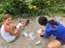 Artists were everywhere, including the gravel path next to the wildflower gardens.